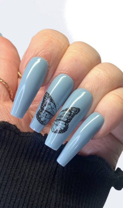 Light blue butterfly nails