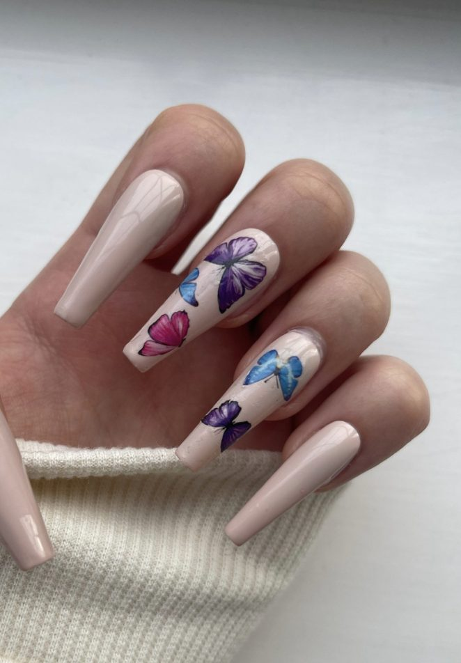 Nude coffin nails with butterfly nail art