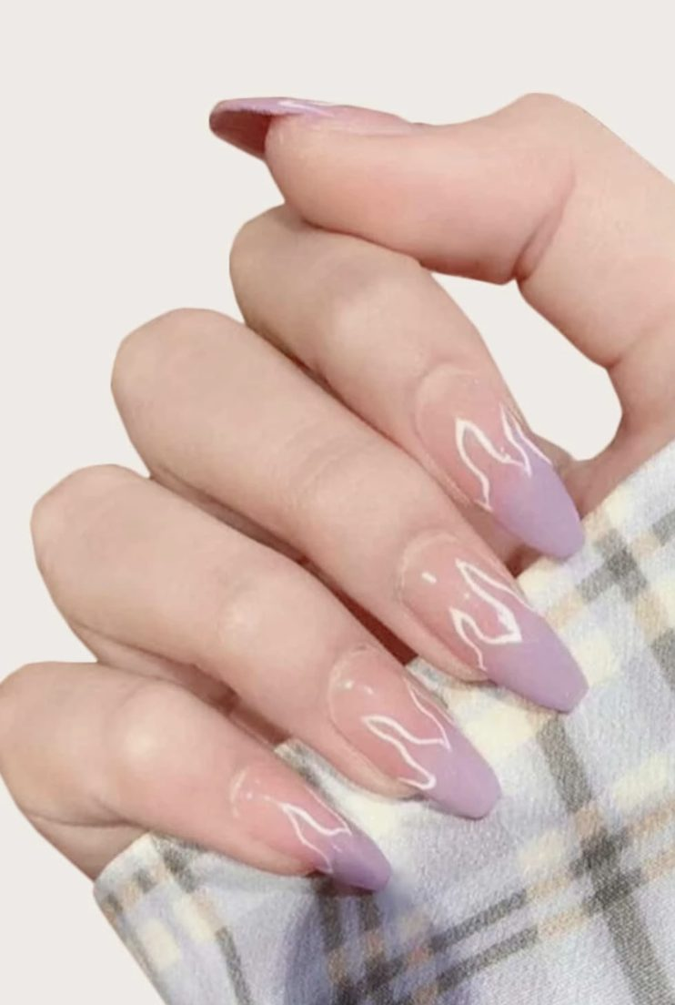 Matte pastel purple nails with flame nail art