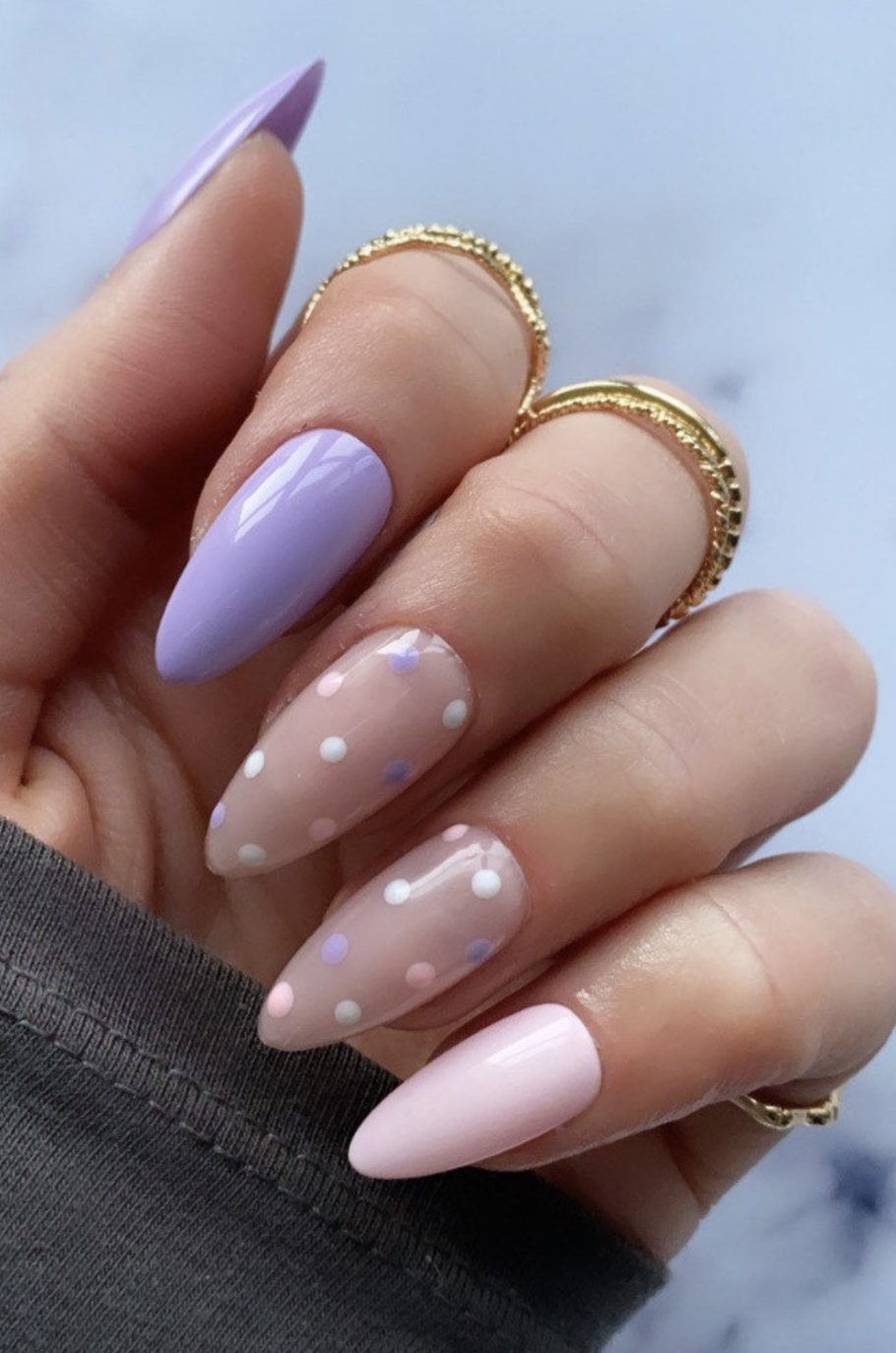 Purple and pink pastel nails with polka dots