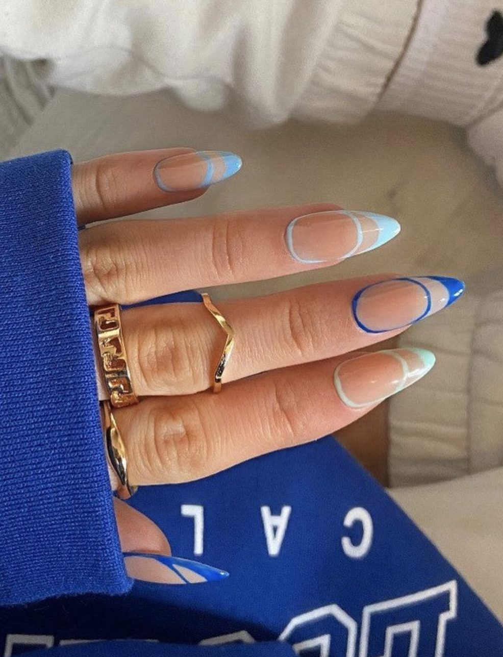 Trendy abstract pastel blue nails with nail art