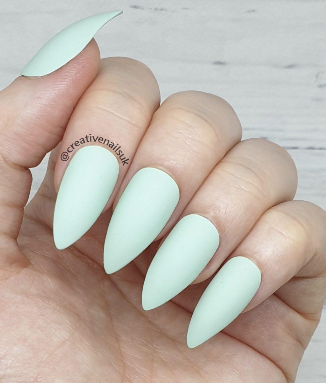 Matte pastel blue short stiletto nails