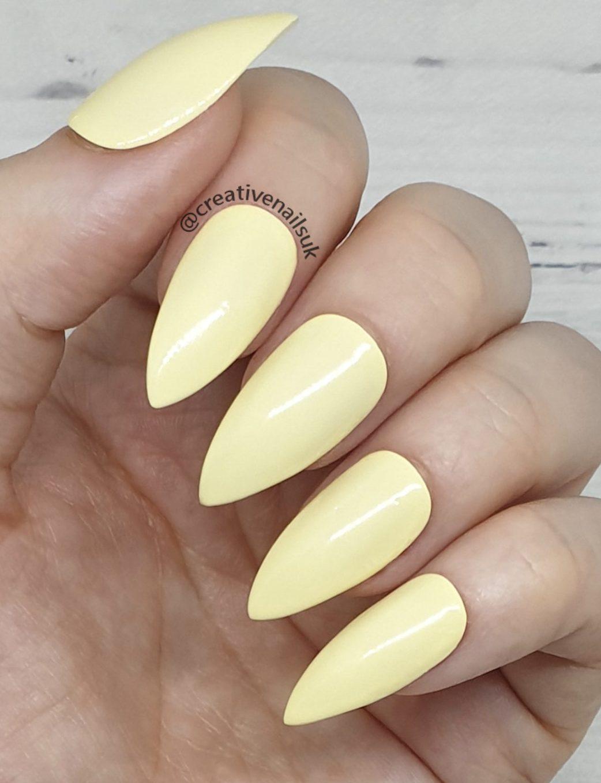 Pastel yellow short stiletto nails