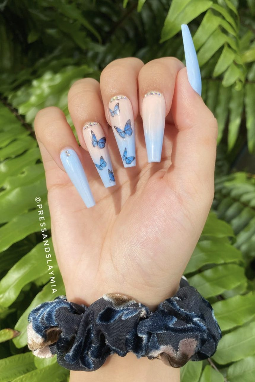 Long light blue ombre nails with butterfly nail art - blue butterfly nails