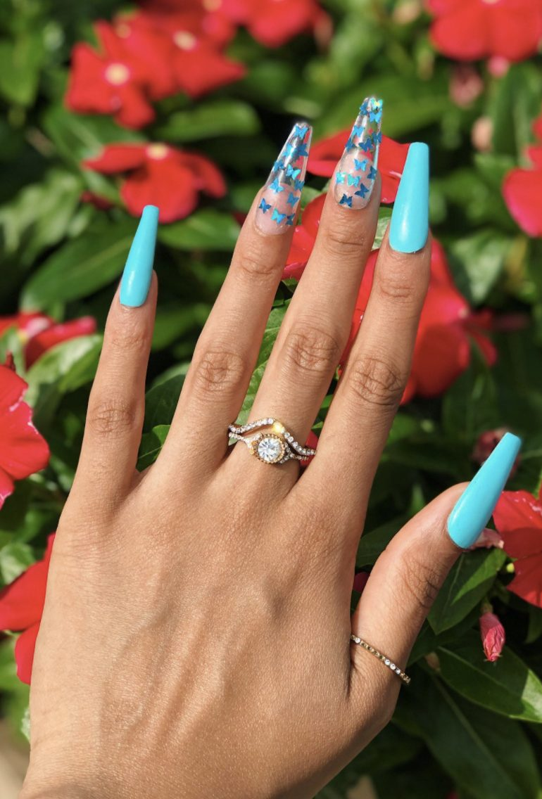 Blue butterfly nails in acrylic coffin shape