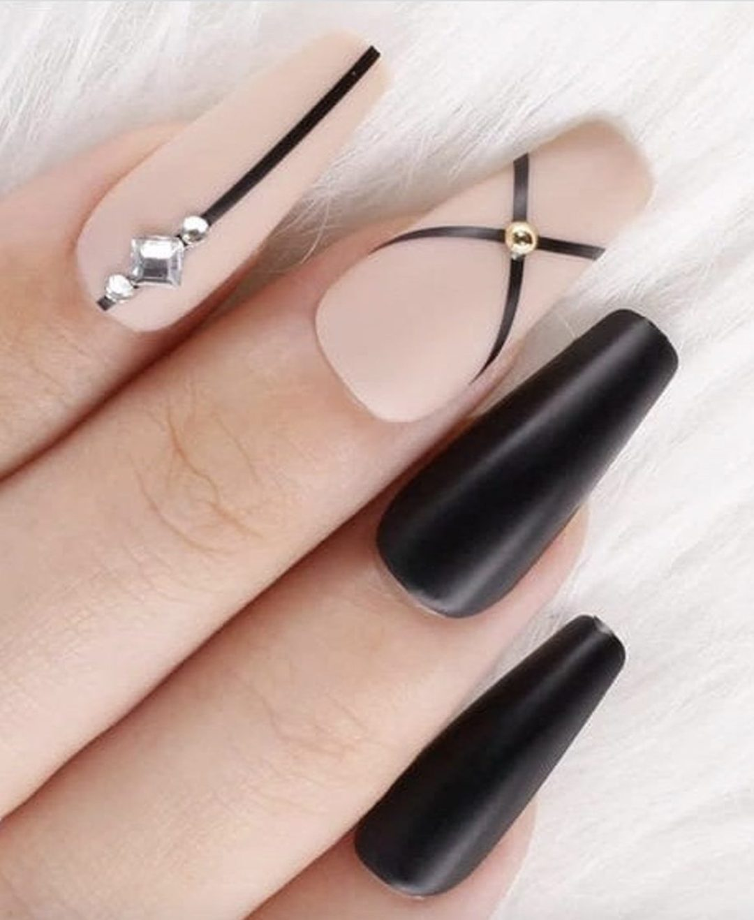 Matte nude and black nails with rhinestones