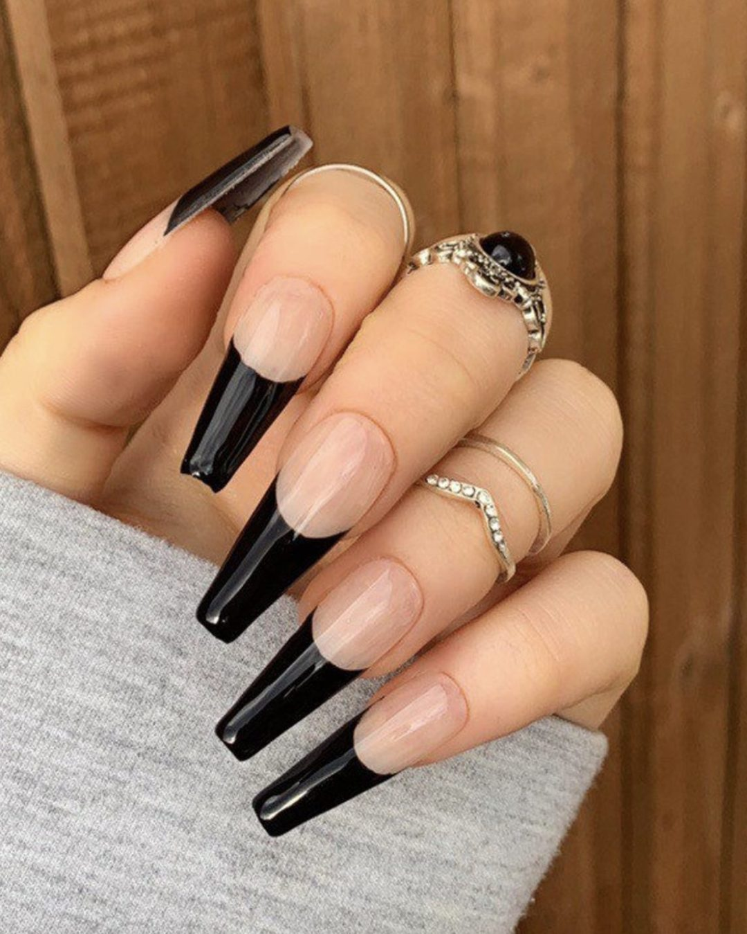 Long black French tip nails in coffin shape