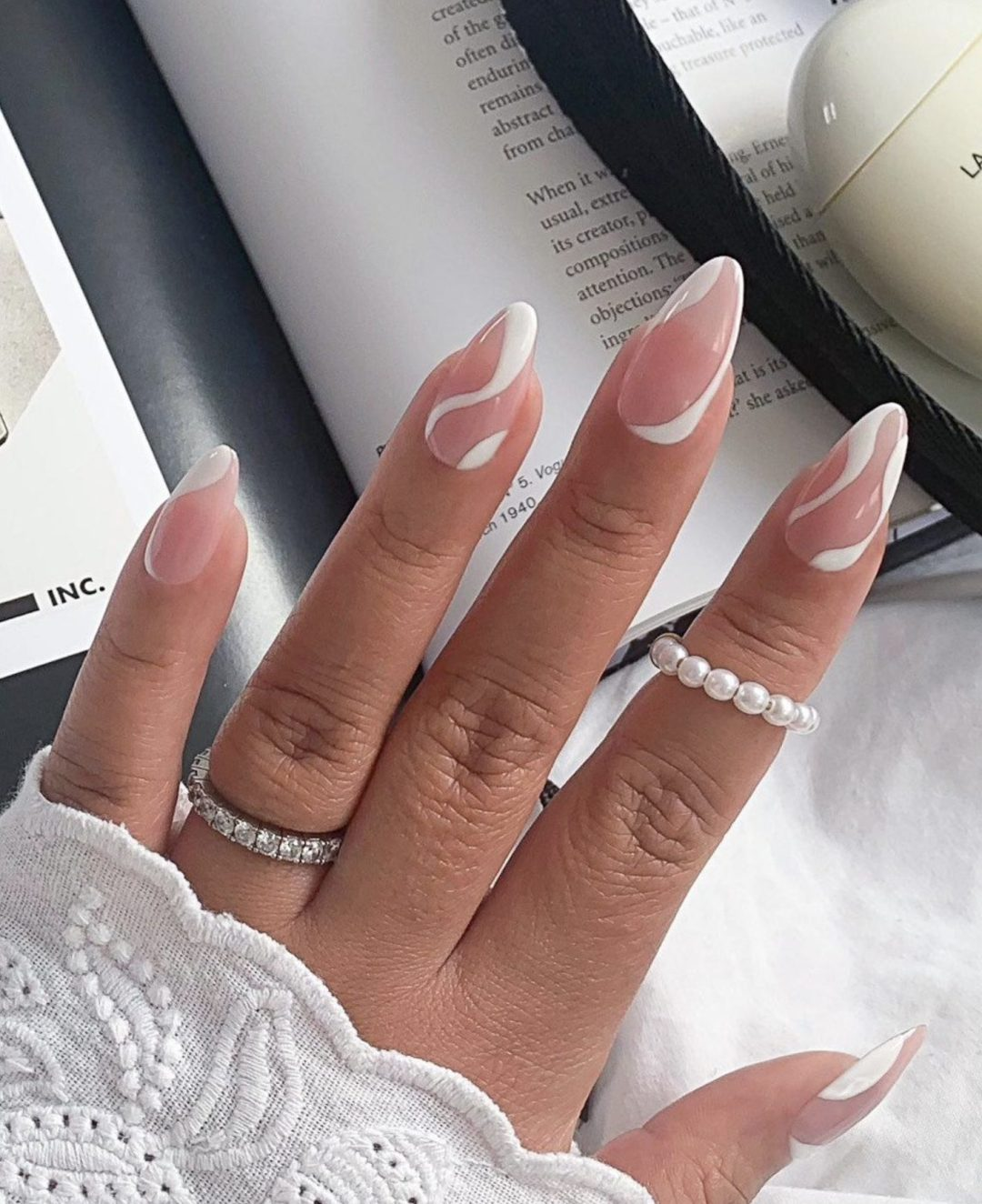 White abstract nails with swirls and lines