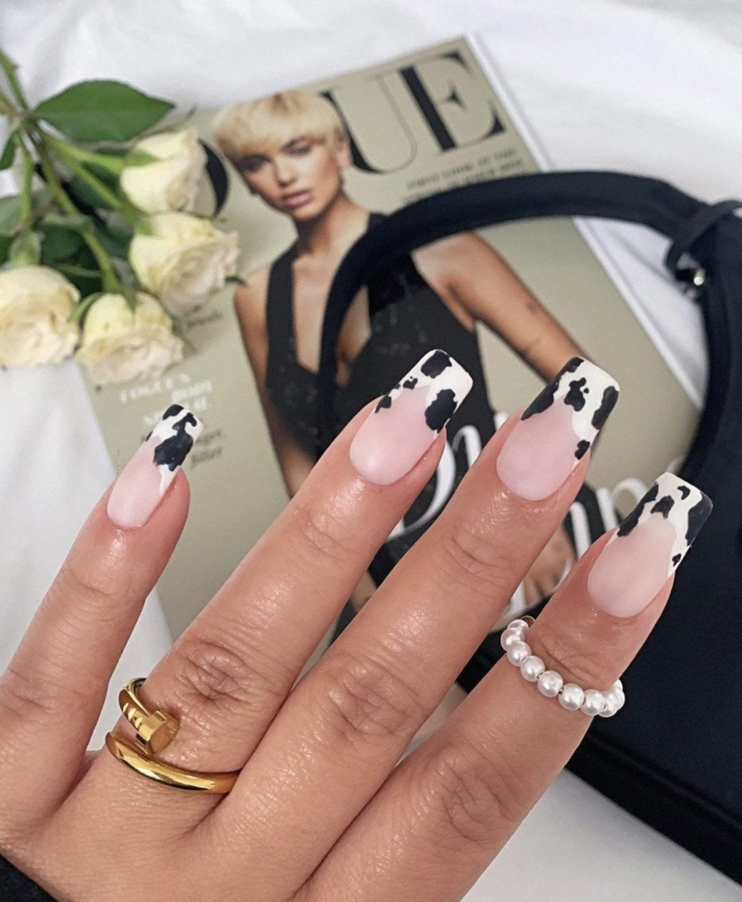 Short cow print French tip nails