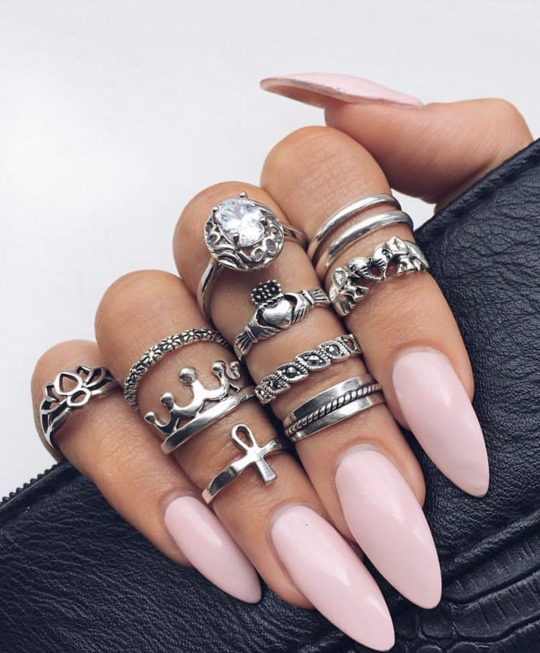 Light pink almond nails with silver midi ring set