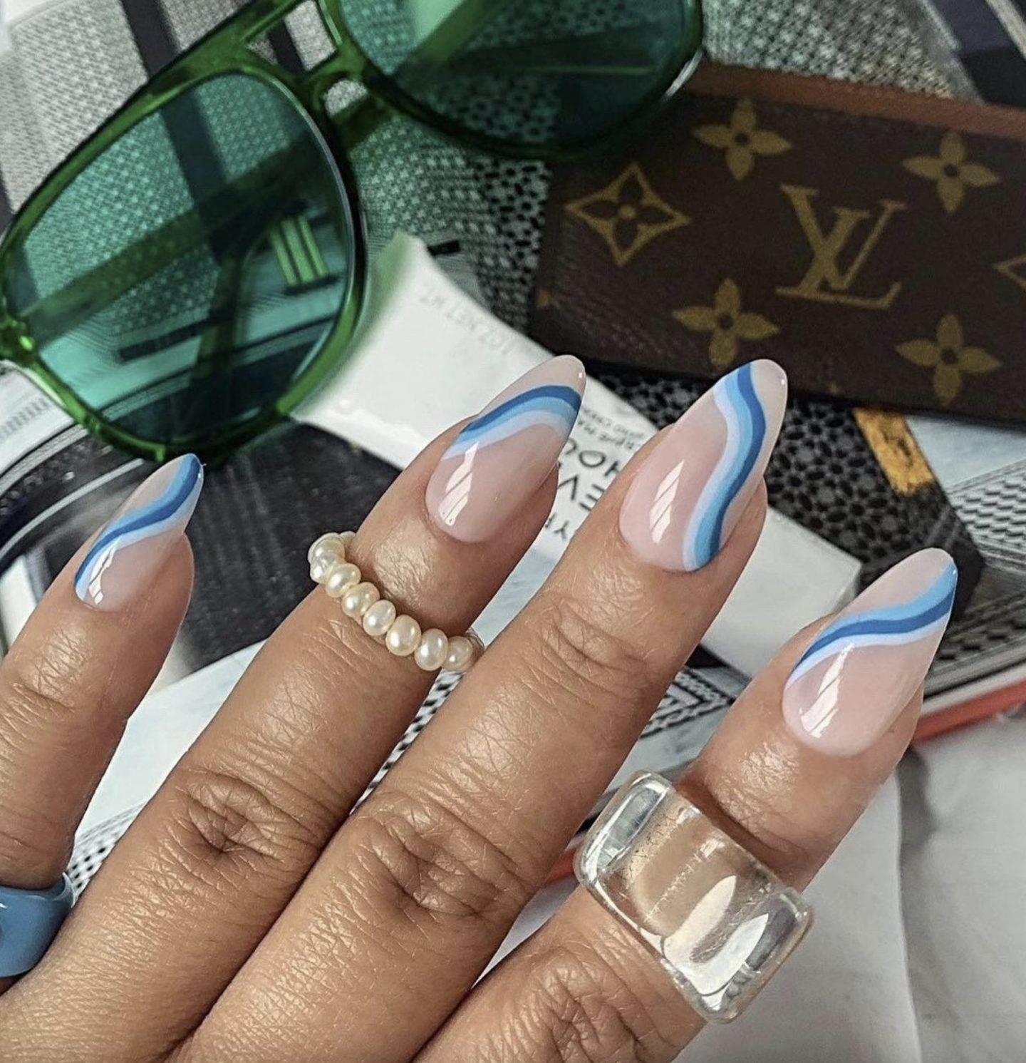 Neutral abstract nails with blue swirls and lines