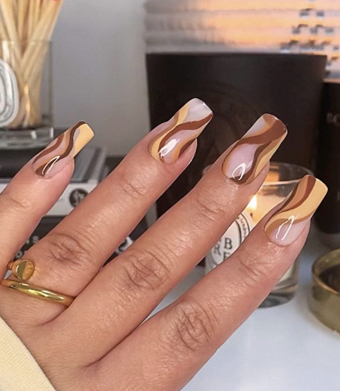 Brown abstract nails with swirls and lines