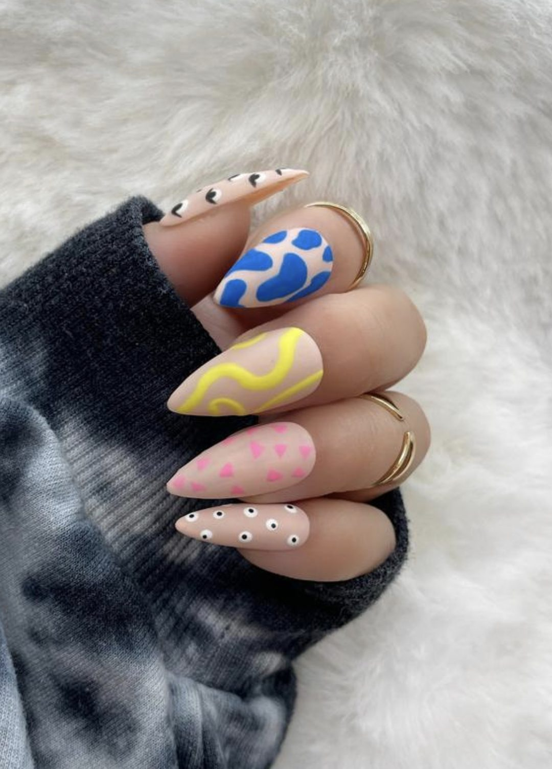 Cute and colorful abstract nails with swirls and patterns