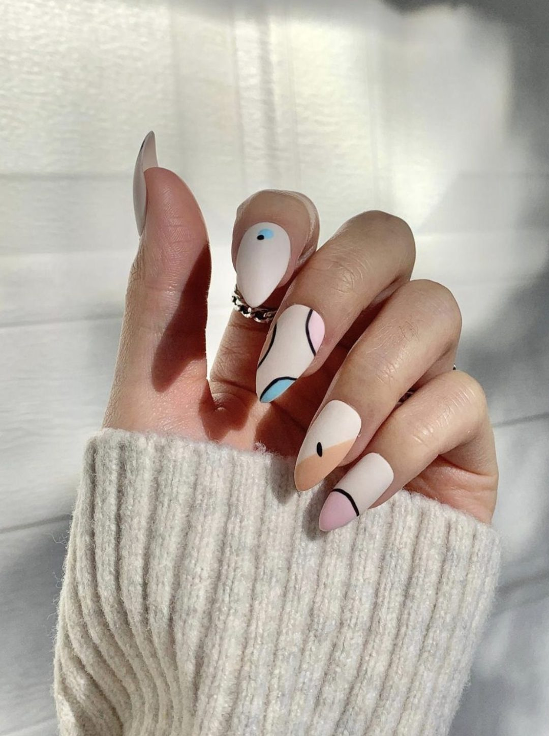 Pastel abstract nails with patterns