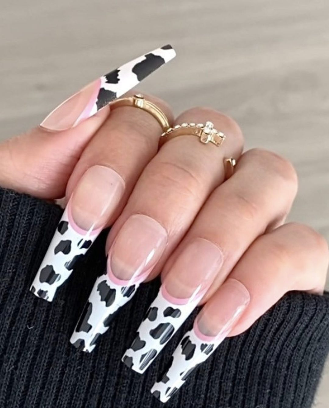 Cow print French tip nails in acrylic coffin shape