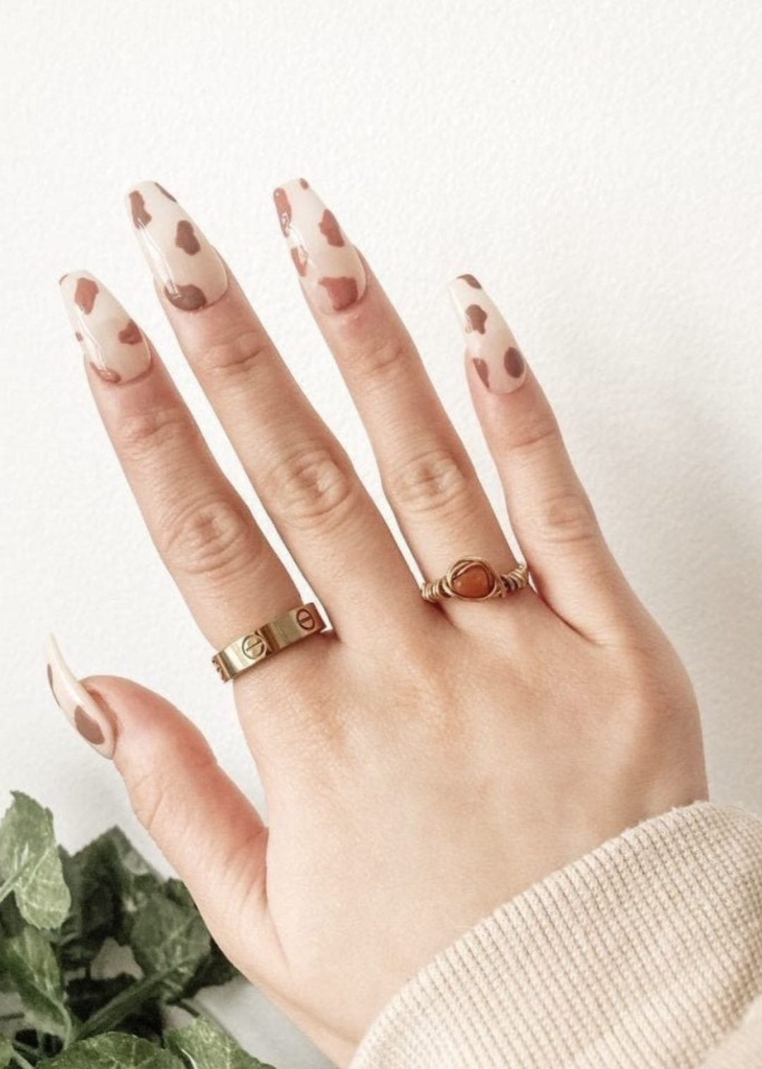 Light brown cow nails with negative space