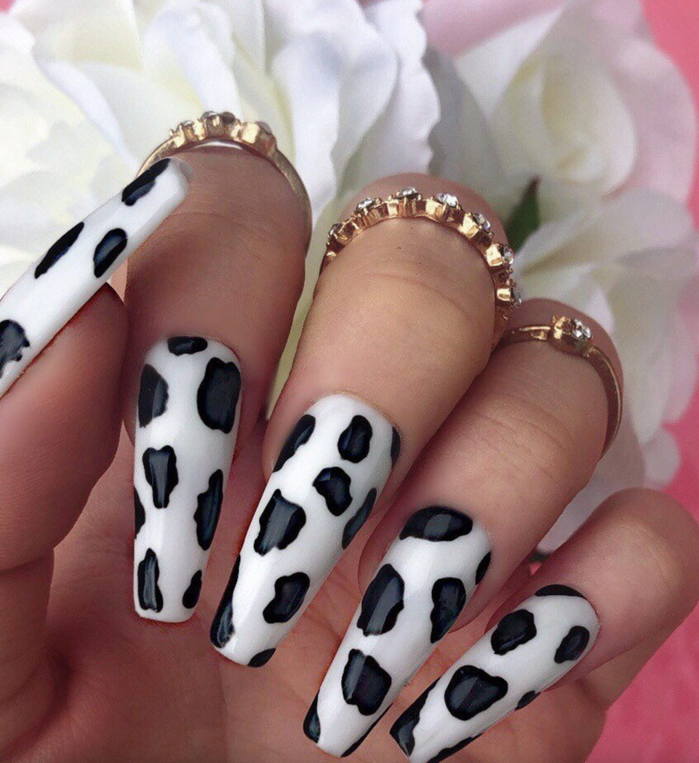 Cute black and white cow nails in acrylic coffin shape