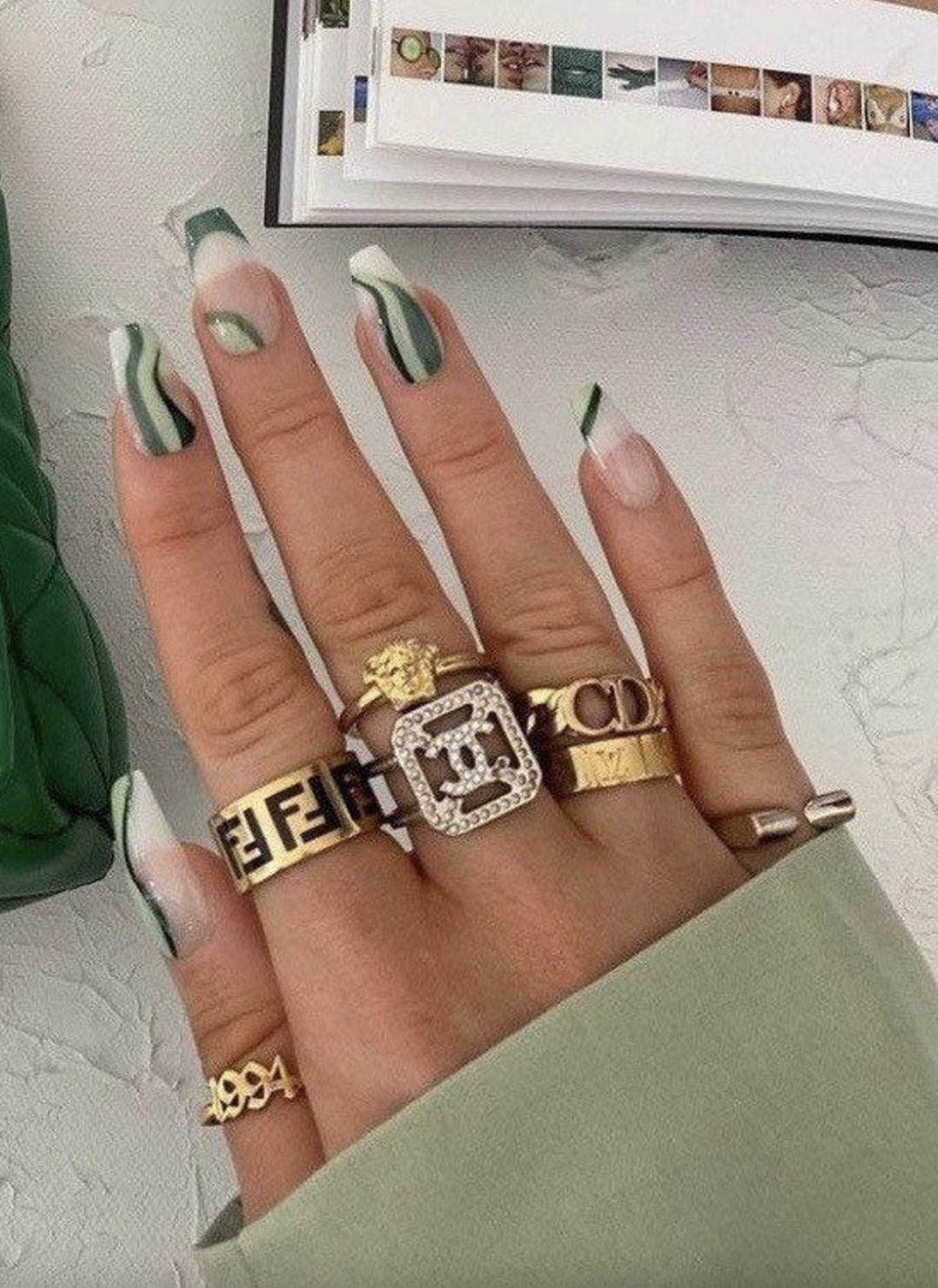 Sage green abstract nails with swirls