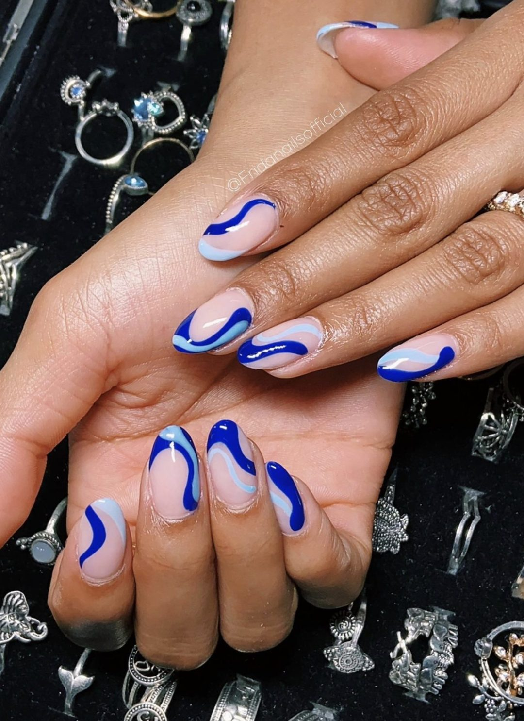 Blue abstract nails with lines and swirls