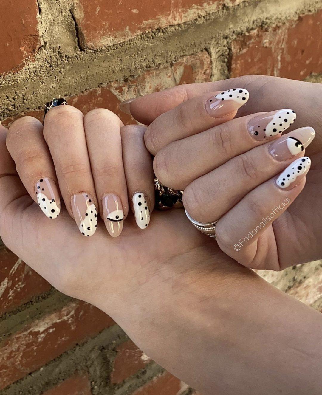 Cute white polka dot nails with eye