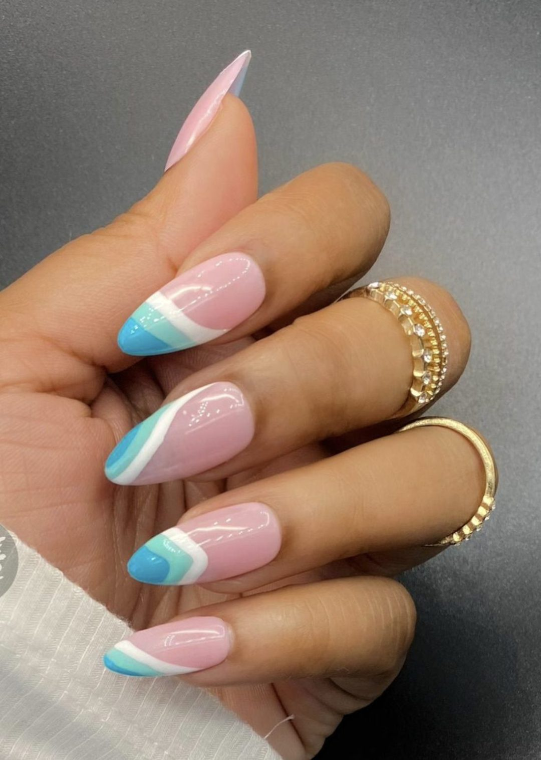 Cute pastel blue French tip nails with abstract swirls