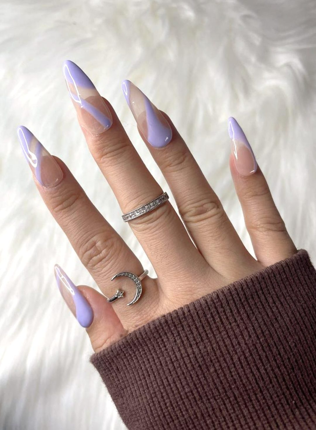 Pastel purple abstract nails with swirls