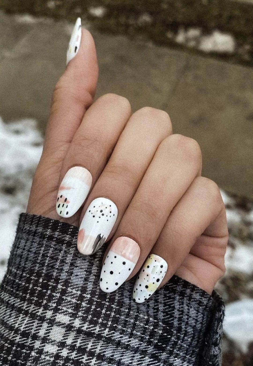 White abstract nails with minimalist patterns