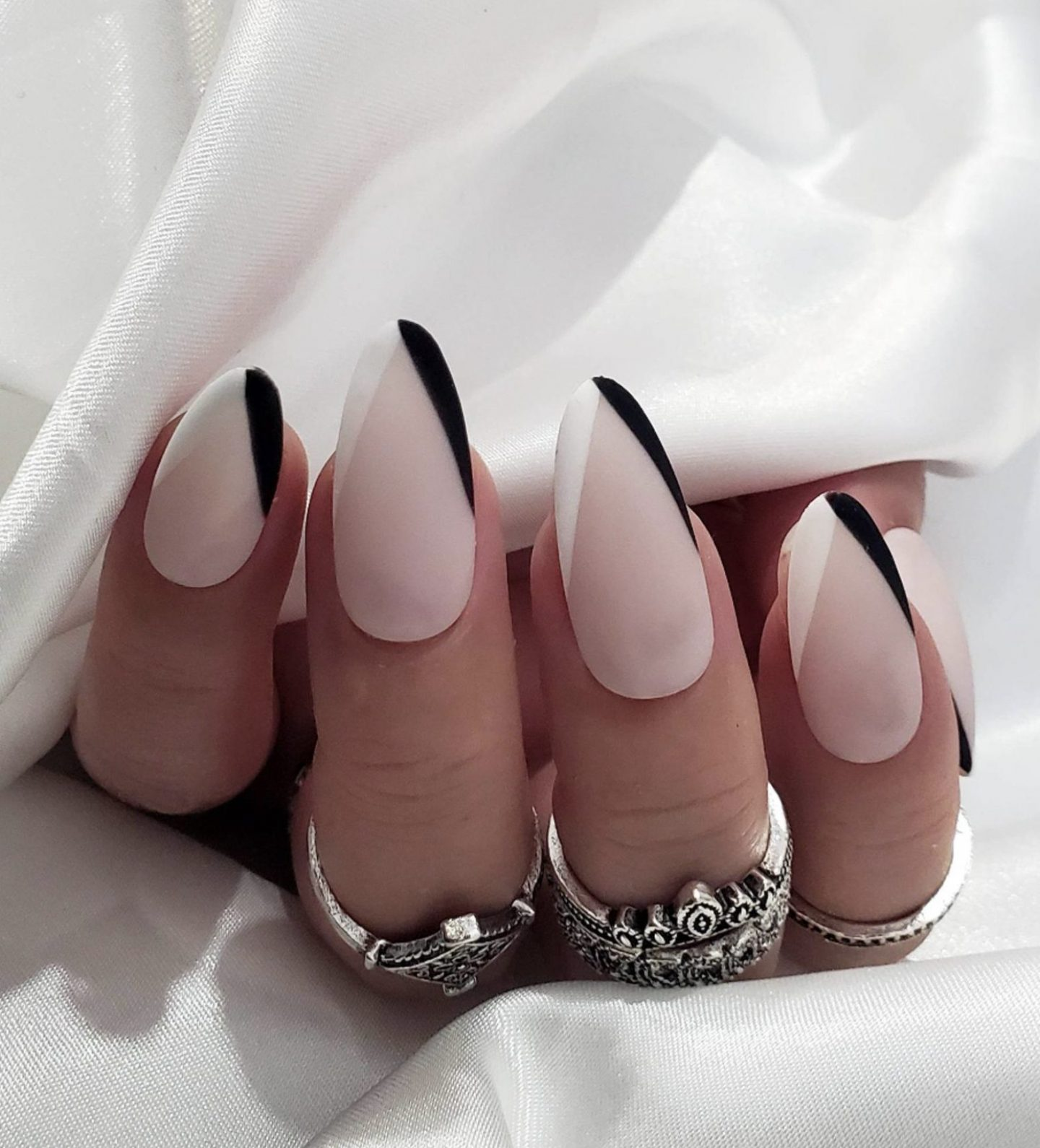 Minimalist black and white French tip nails