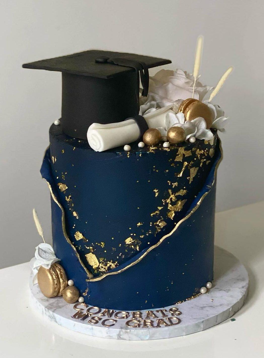 Blue grad cake with cap