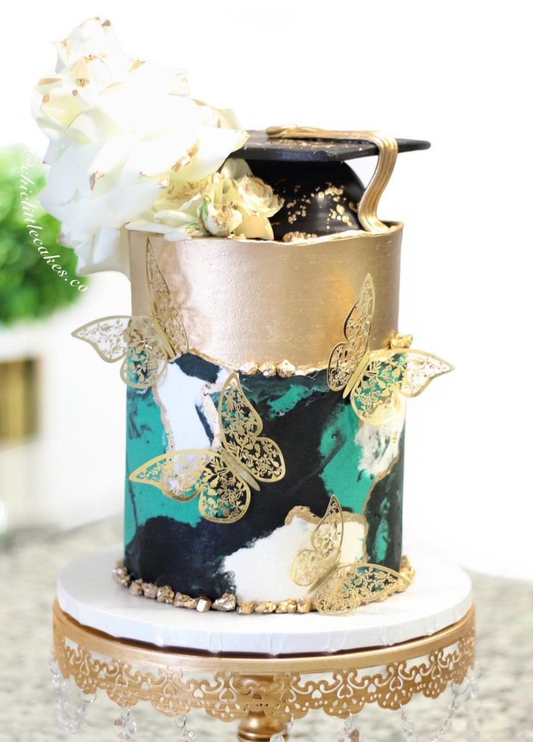 Gold graduation cake with butterflies