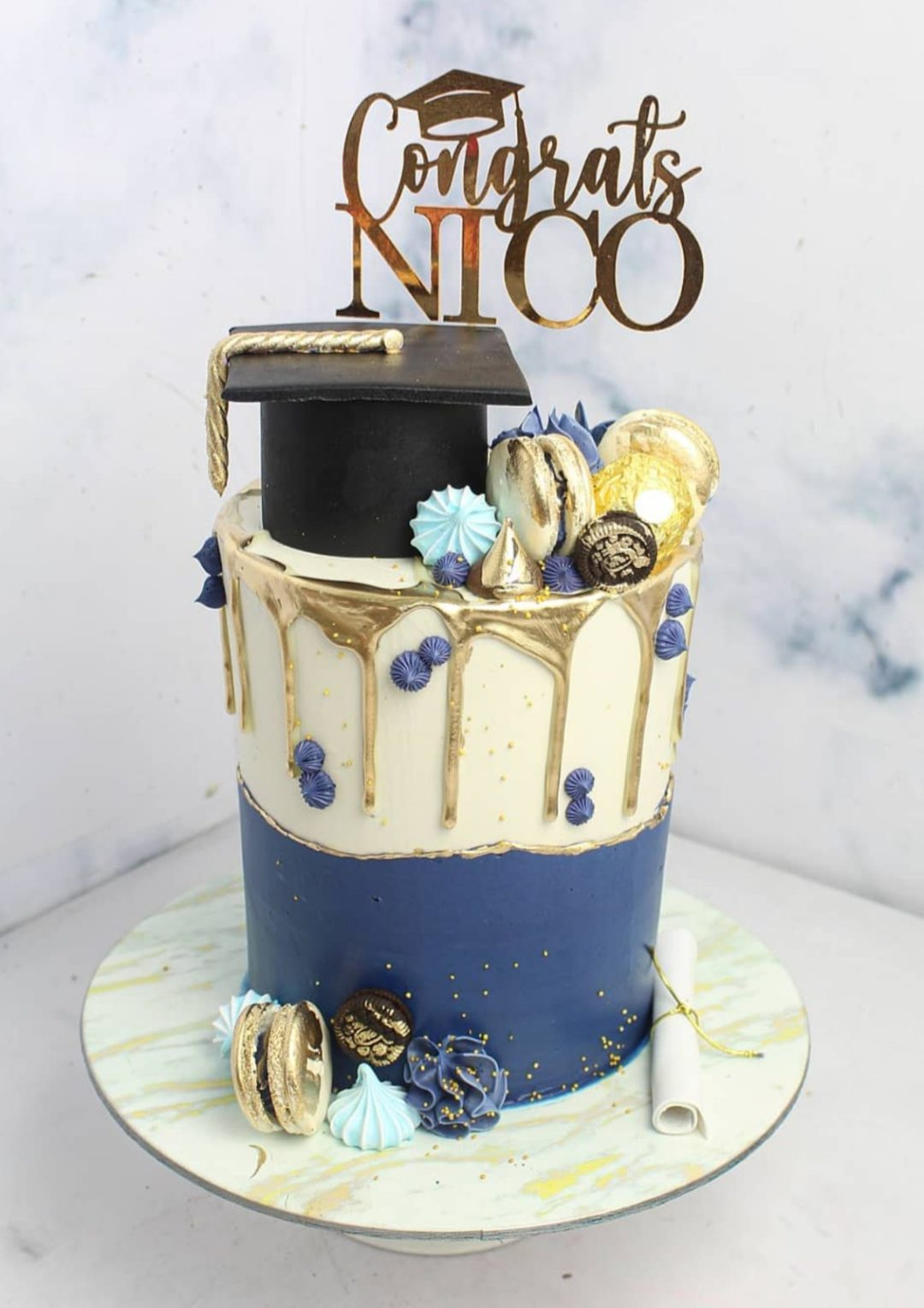 Elegant grad cake with blue and white