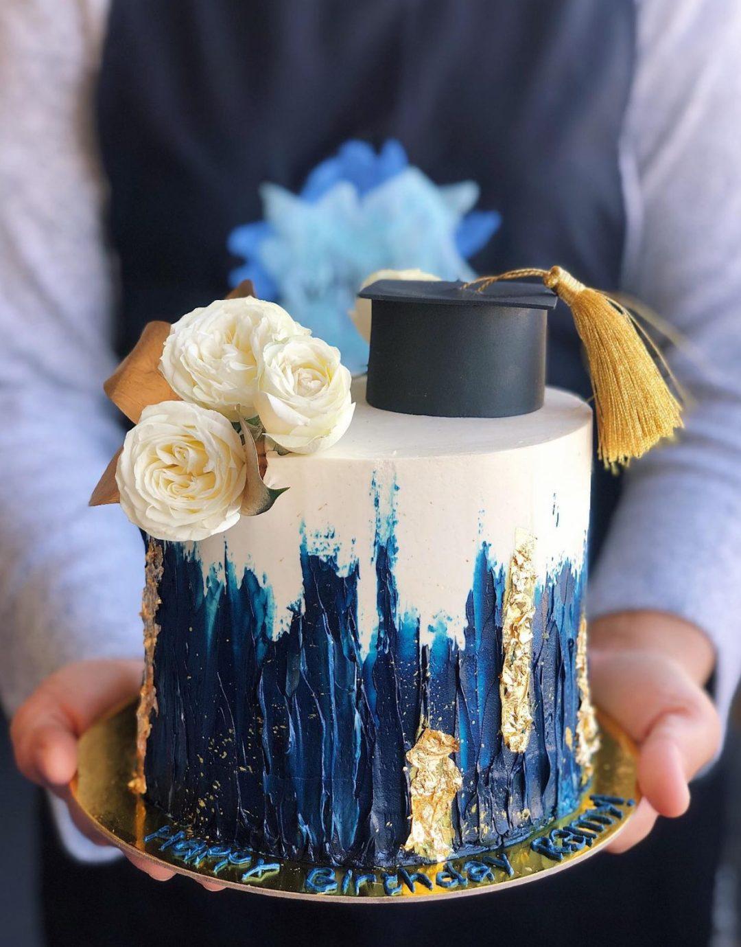 Elegant white, blue and gold grad cake