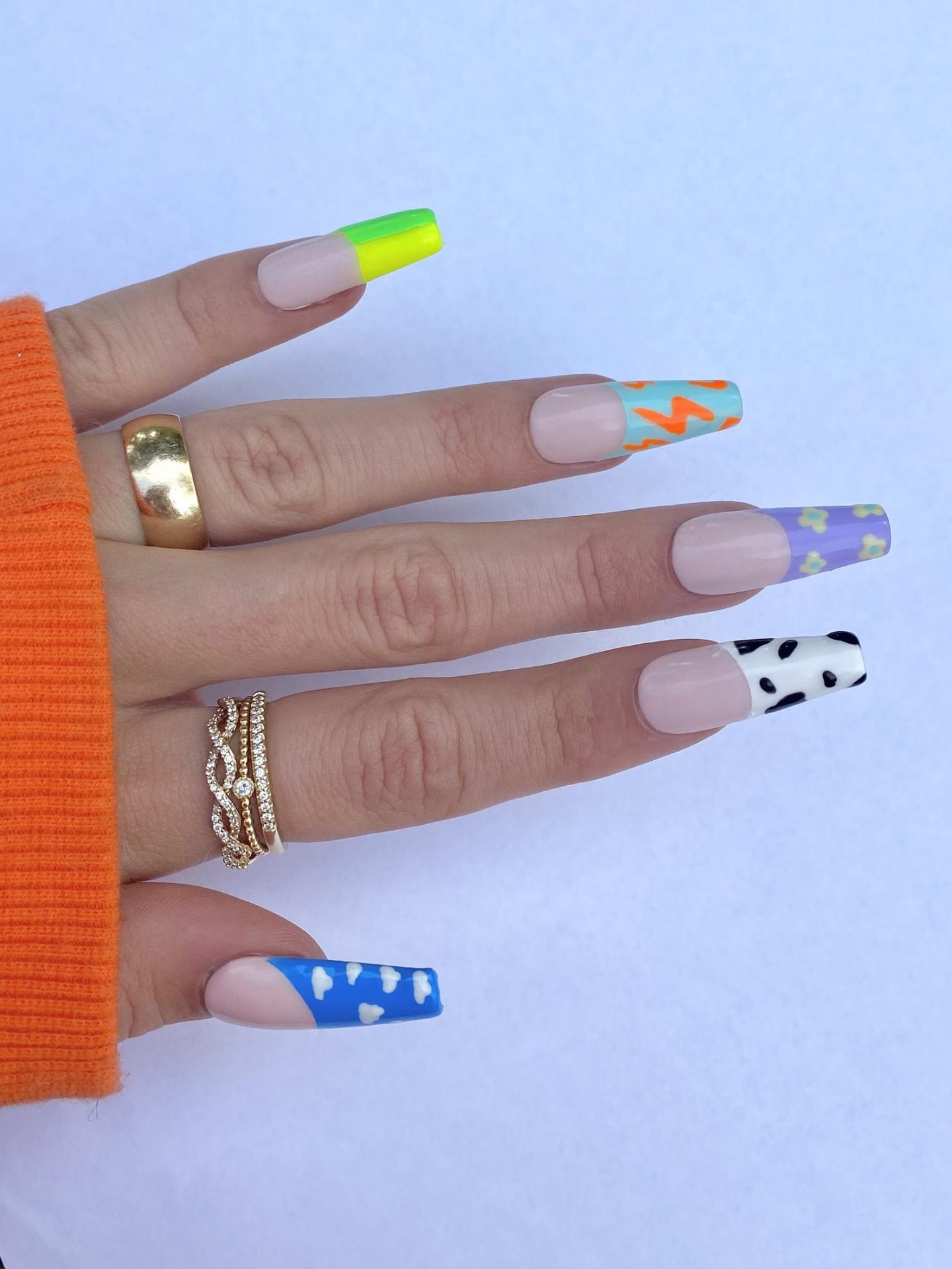 Colorful mismatched French tip nails