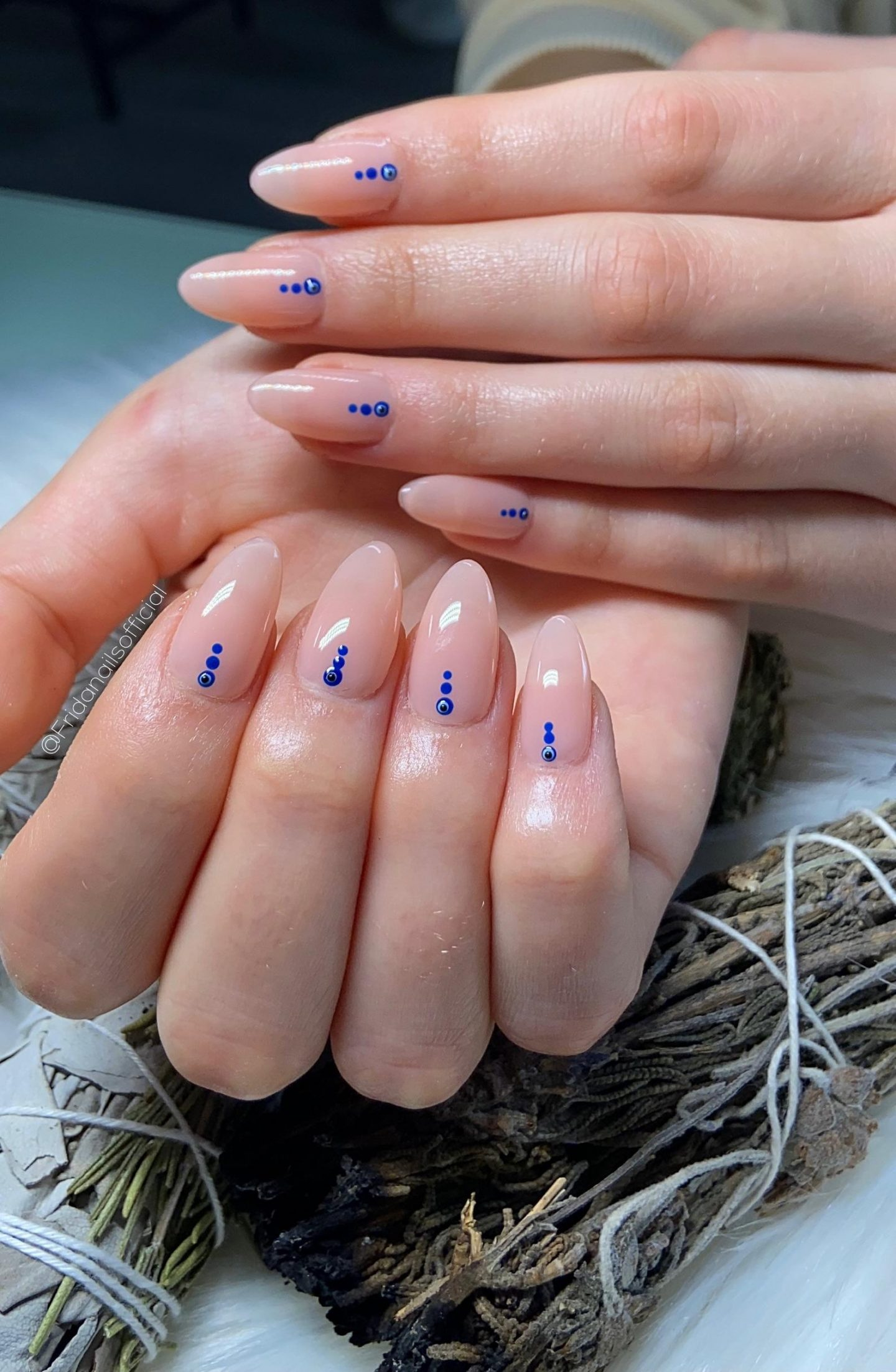 Minimalist nails with blue dots