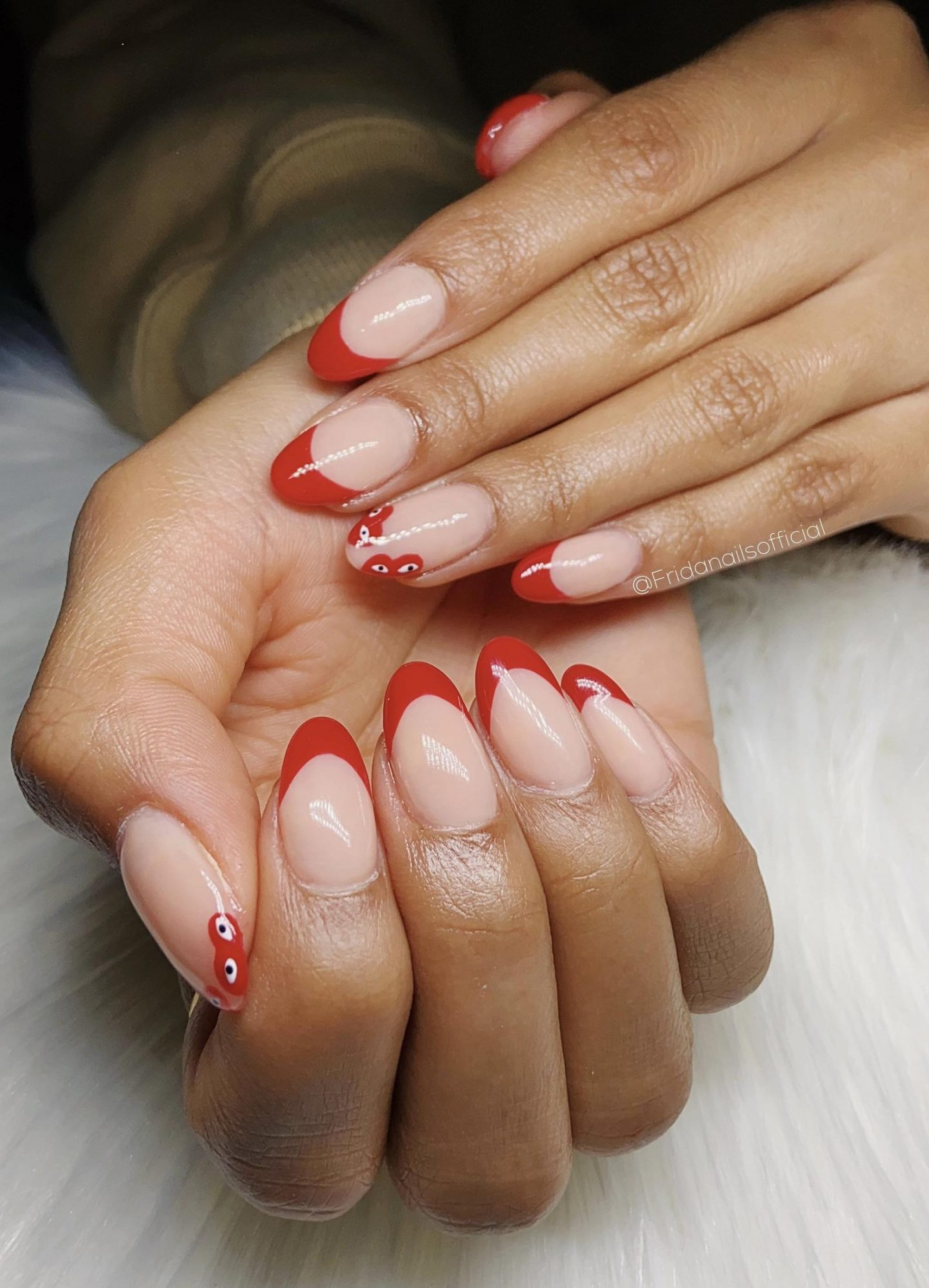 Red French tip nails inspired by Comme Des Garcons