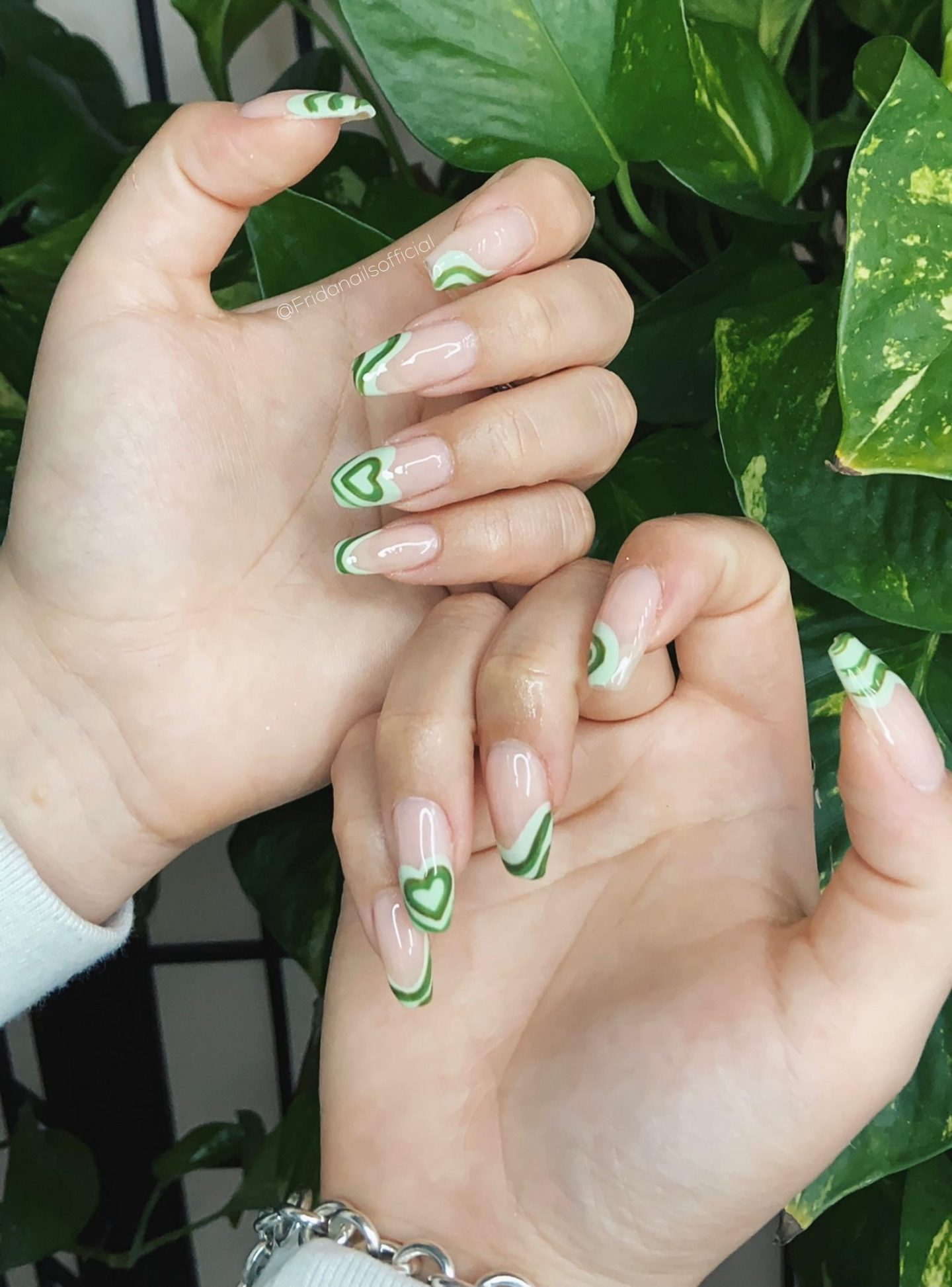 Abstract green French tip nails with hearts