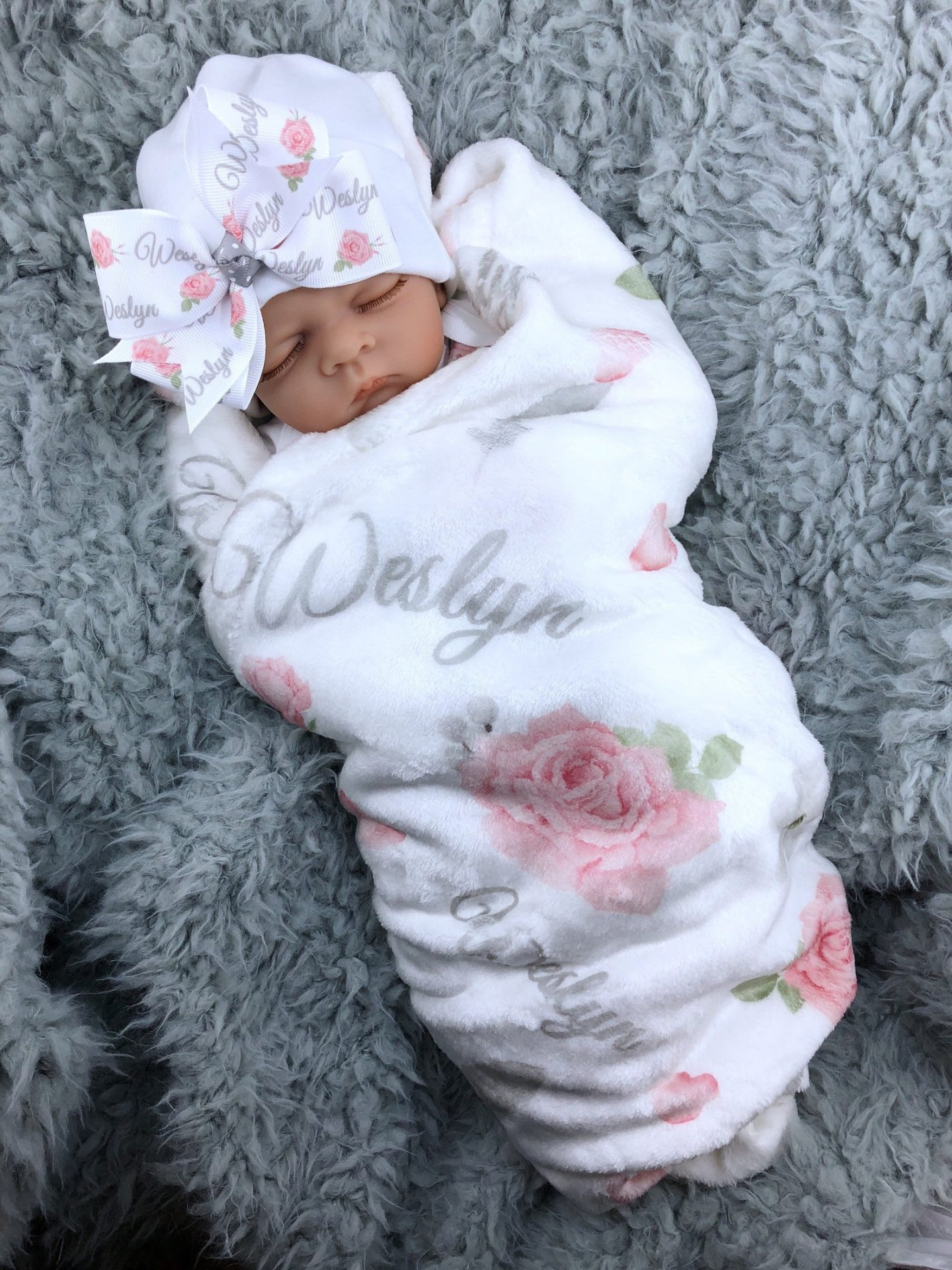 White and pink baby blanket for newborns