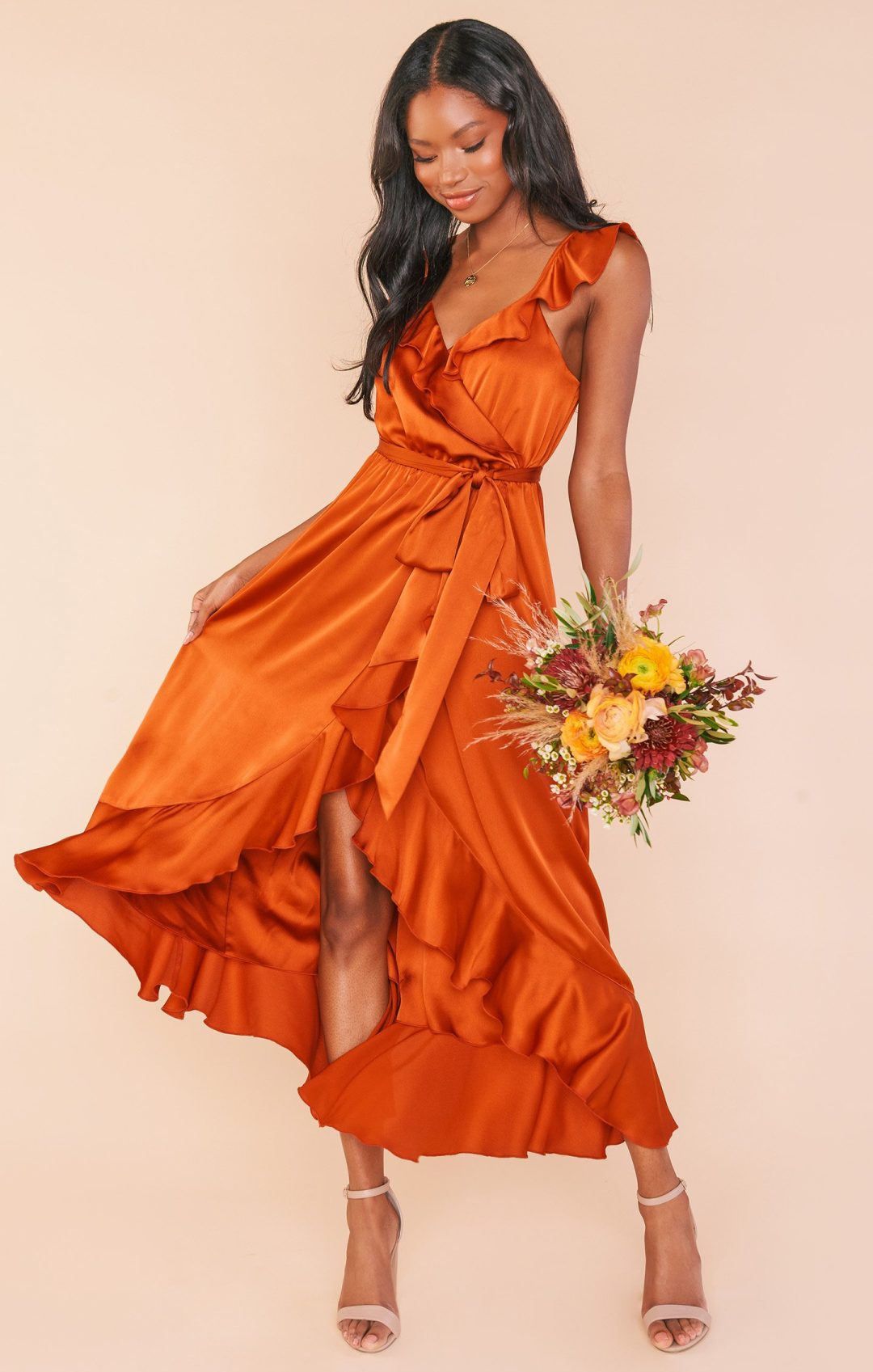 Orange bridesmaid dress with ruffles