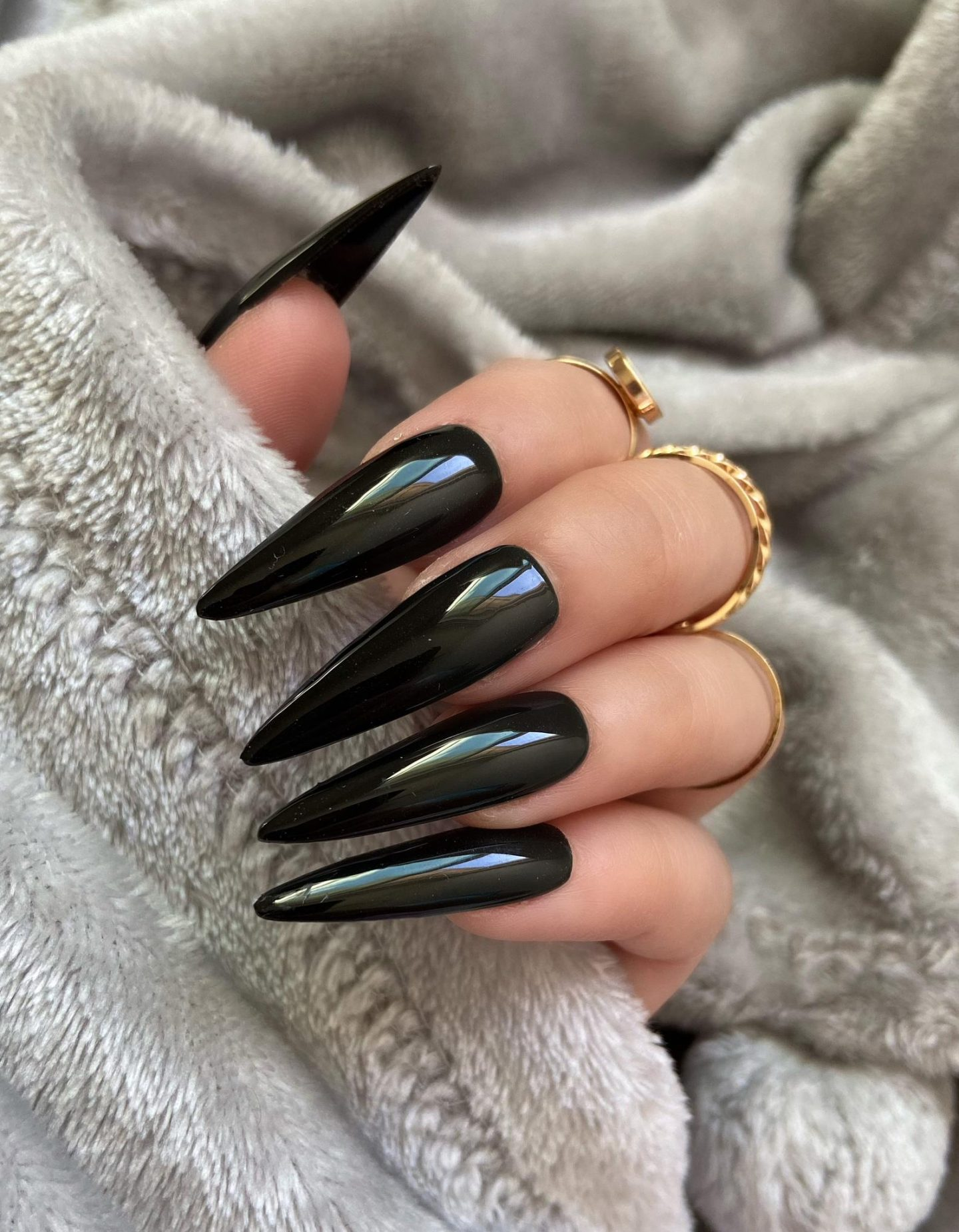 Long glossy black stiletto nails