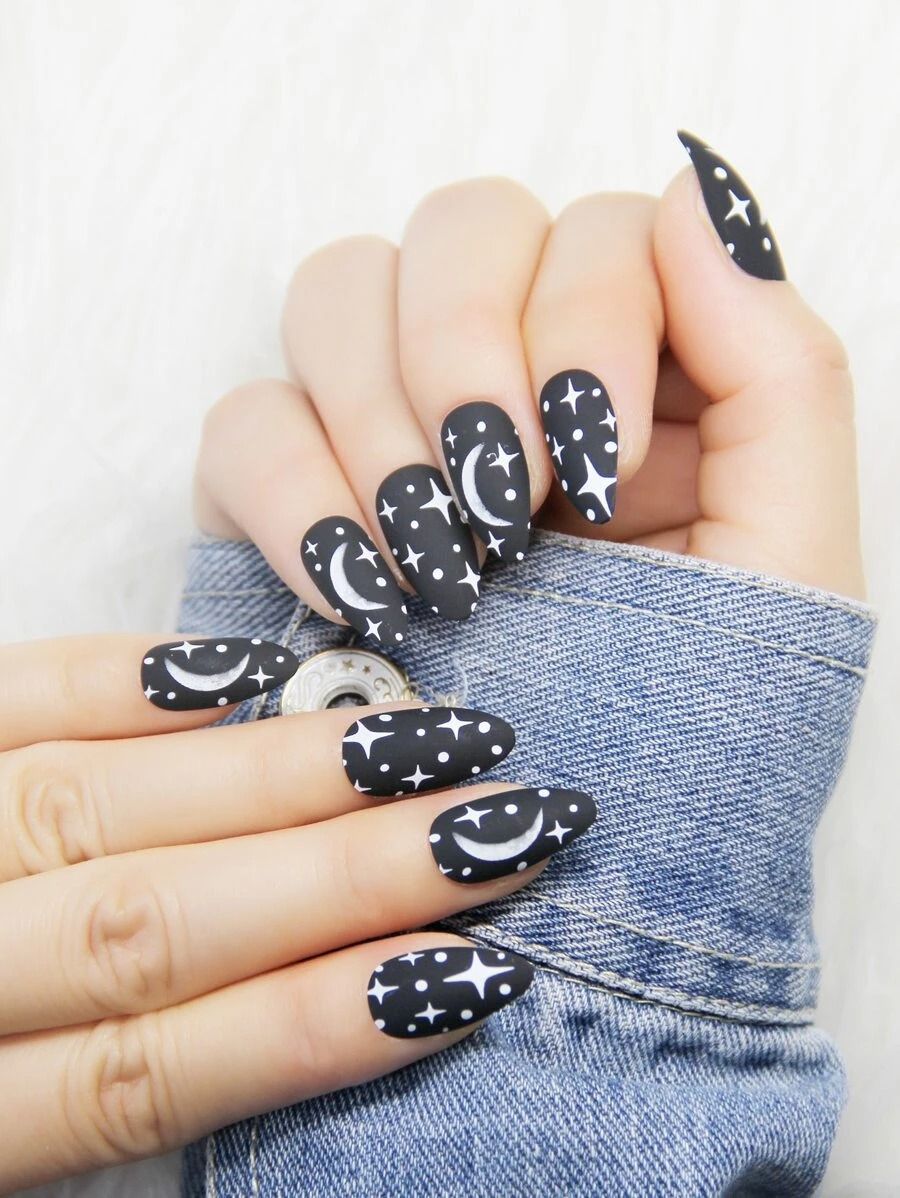 Matte black almond nails with moon and stars