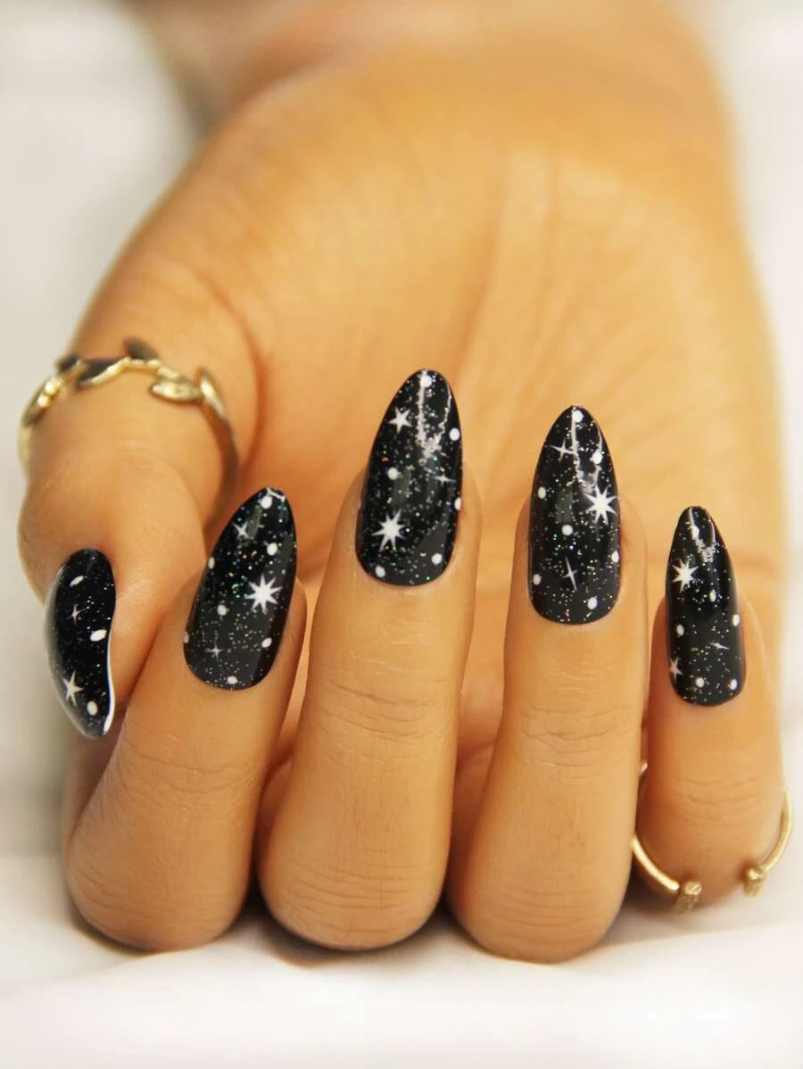 Short black almond nails with moon and stars