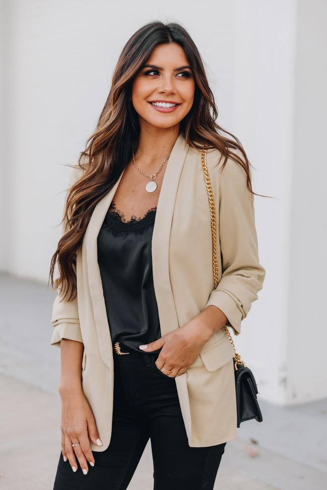 Beige blazer outfit with black jeans