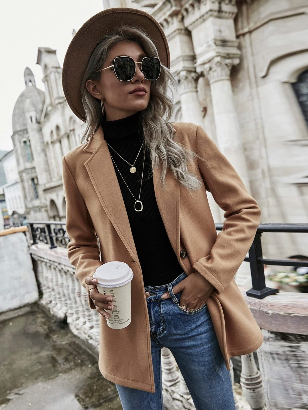 Beige blazer outfit with fedora hat and jeans