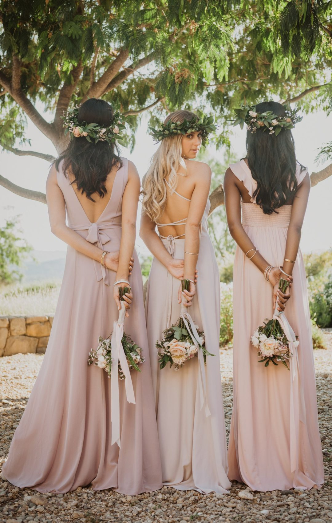 Mismatched blush pink, dusty pink and mauve bridesmaid dresses