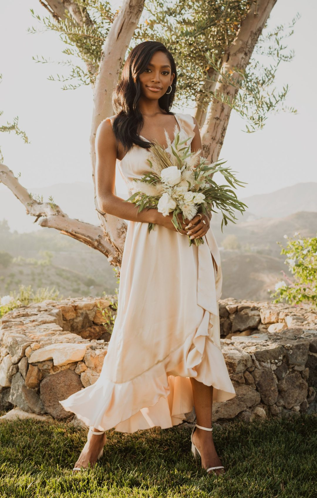 Blush pink bridesmaid dress with ruffles