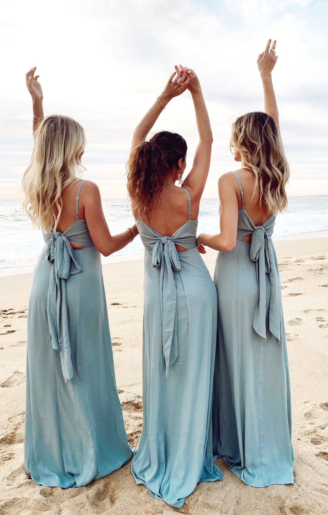 Long and dusty blue bridesmaid dresses with tie ribbon