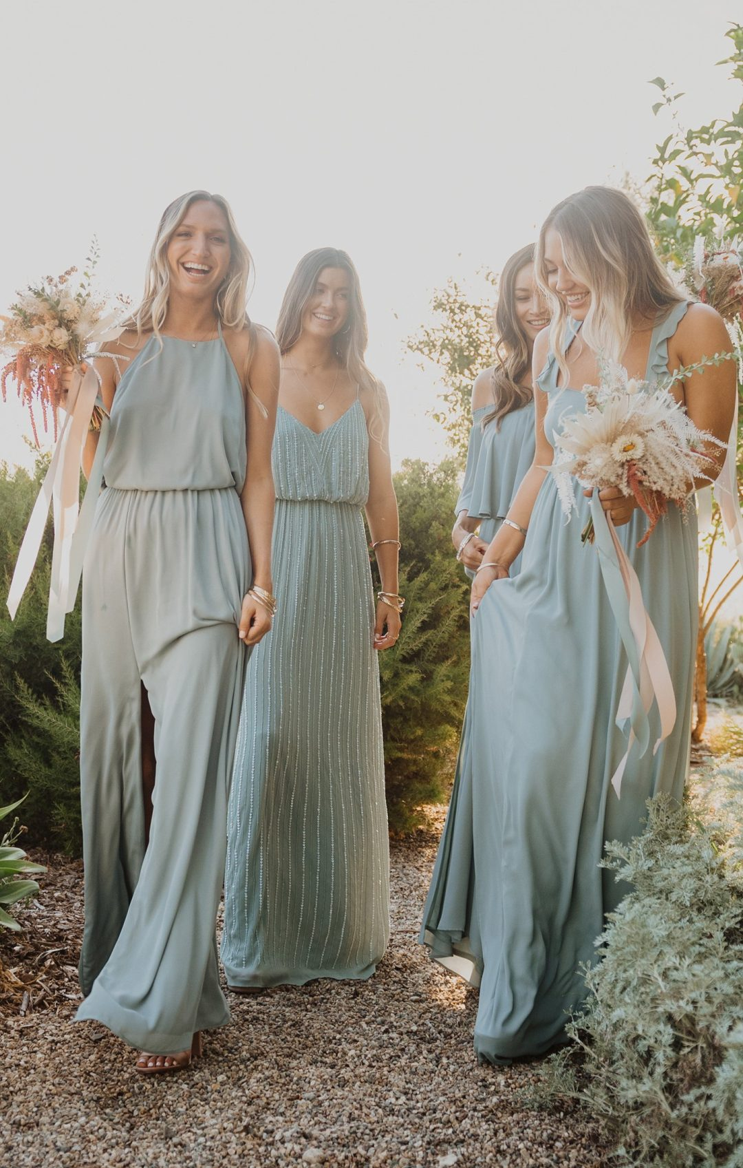 Mismatched grey and sage green bridesmaid dresses