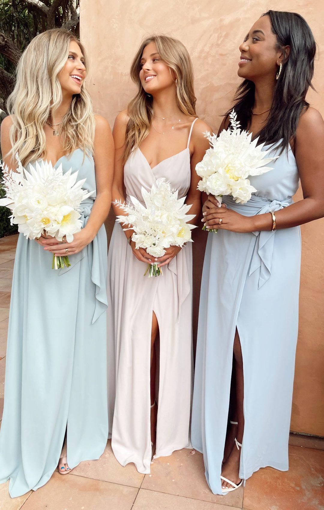 Mismatched pale pink and pale blue bridesmaid dresses