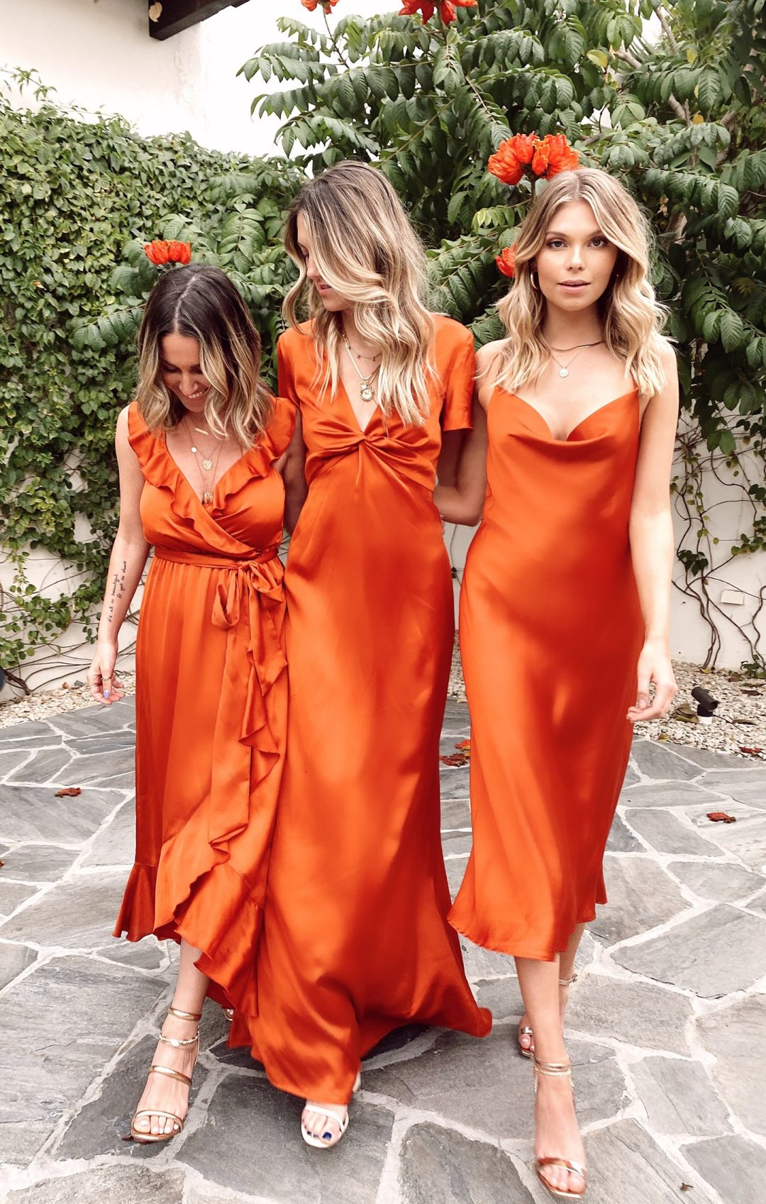 Mismatched orange and red bridesmaid dresses