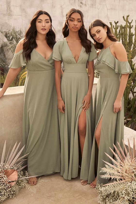 Mismatched sage green bridesmaid dresses with sleeves with slit